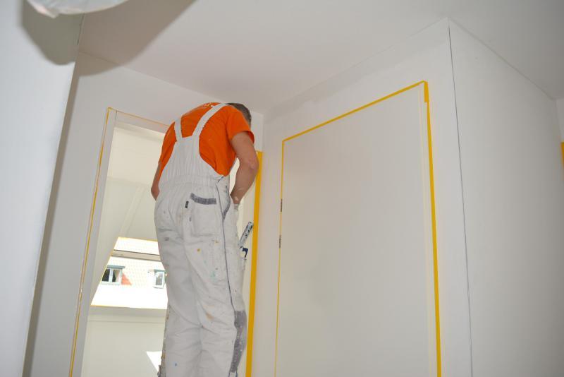Afplakken deur schilderen