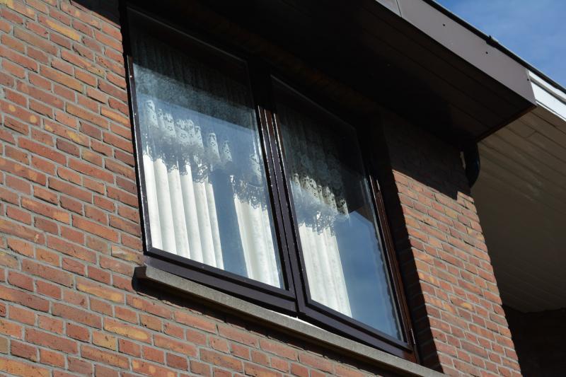 Schilderwerk raam tweede verdieping