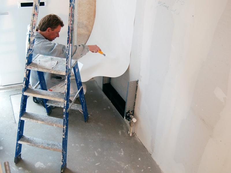 Vliesbehang aanbrengen in woning Den Haag